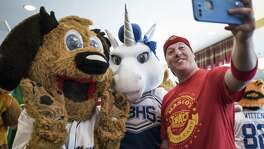 Jerome Bartlett, right, practices taking a selfie with Emily Simmons, 13, left, Marshall Middle School mascot, and Abbie Tate, 15, Unis the Unicorn from New Braunfels High School, during the Mascot training camp put on by Higher Impact Entertainment at the Crockett Hotel in San Antonio, TX on Saturday, June 24, 2017. The one-day camp that is in its sixth year, teaches mascots from middle school to the professional level how to care for their costumes, interact with fans and improve their skills. The workshop is directed by Higher Impact Entertainment director Jerome Bartlett, a former mascot for the Spurs organization as a backup Coyote, T-Bone for the Rampage, and was named the 2006 National Mascot Champion.