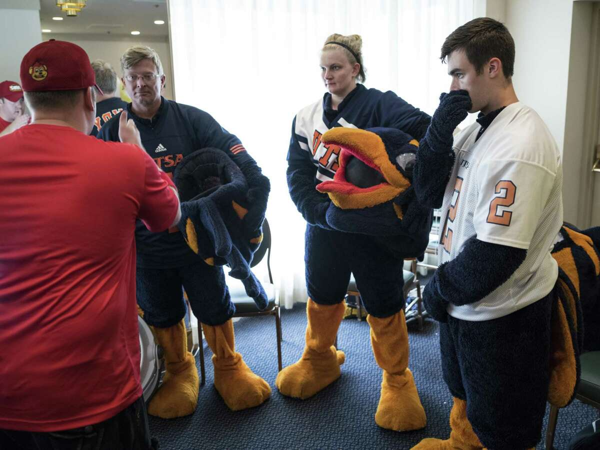 From left, mascots for Rowdy from UTSA, Jared Dugger, 42, Jessica Miller, 25, and Henry Banowski, 19, listen as Jerome Bartlett, left, talks to them about photo awareness during the Mascot training camp put on by Higher Impact Entertainment at the Crockett Hotel in San Antonio, TX on Saturday, June 24, 2017. The one-day camp that is in its sixth year, teaches mascots from middle school to the professional level how to care for their costumes, interact with fans and improve their skills. The workshop is directed by Higher Impact Entertainment director Jerome Bartlett, a former mascot for the Spurs organization as a backup Coyote, T-Bone for the Rampage, and was named the 2006 National Mascot Champion.