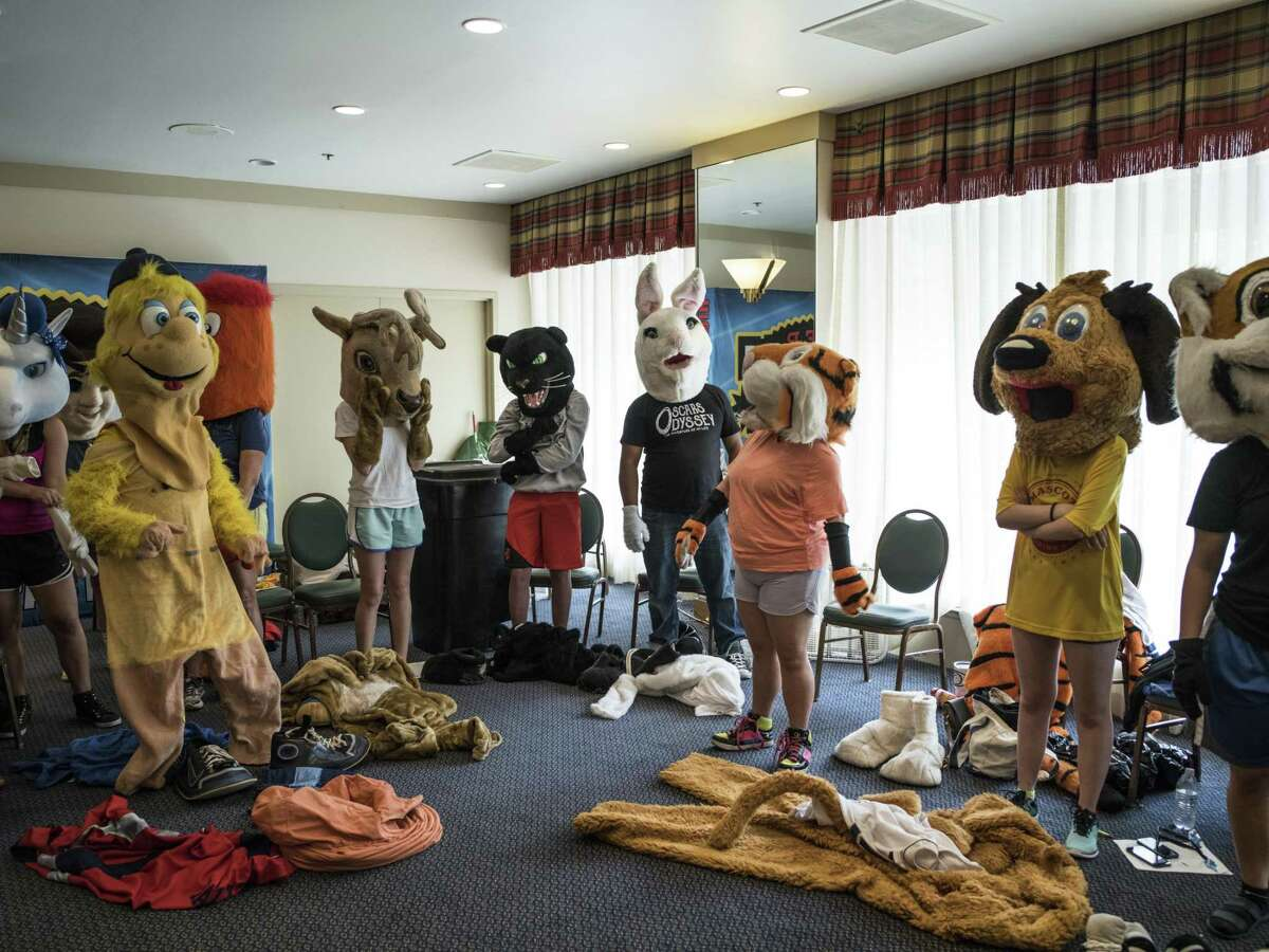 Mascots dress in their costumes during the Mascot training camp put on by Higher Impact Entertainment at the Crockett Hotel in San Antonio, TX on Saturday, June 24, 2017. The one-day camp that is in its sixth year, teaches mascots from middle school to the professional level how to care for their costumes, interact with fans and improve their skills. The workshop is directed by Higher Impact Entertainment director Jerome Bartlett, a former mascot for the Spurs organization as a backup Coyote, T-Bone for the Rampage, and was named the 2006 National Mascot Champion.