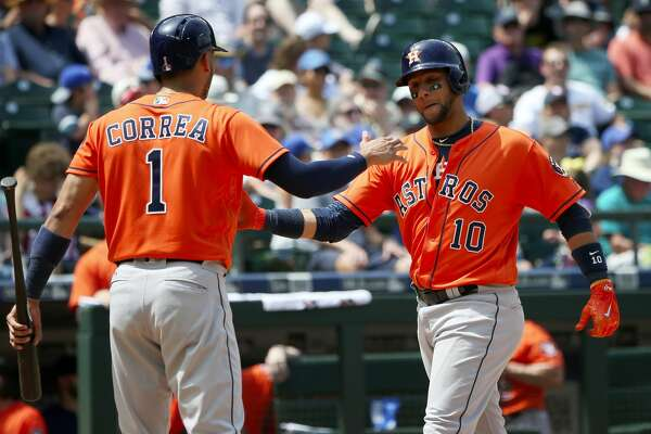 After his home run, Houston Astros first baseman Yuli Gurriel (10) is welcomed at home plate by teammate Carlos Correa (1) in the fourth inning against the Seattle Mariners on Sunday, June 25, 2017, at Safeco Field in Seattle, Wash. (Ken Lambert/Seattle Times/TNS)