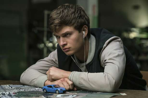 """This image released by Sony-TriStar Pictures shows Ansel Elgort as Baby in a scene from """"Baby Driver."""" (Wilson Webb/Sony/TriStar via AP)"""