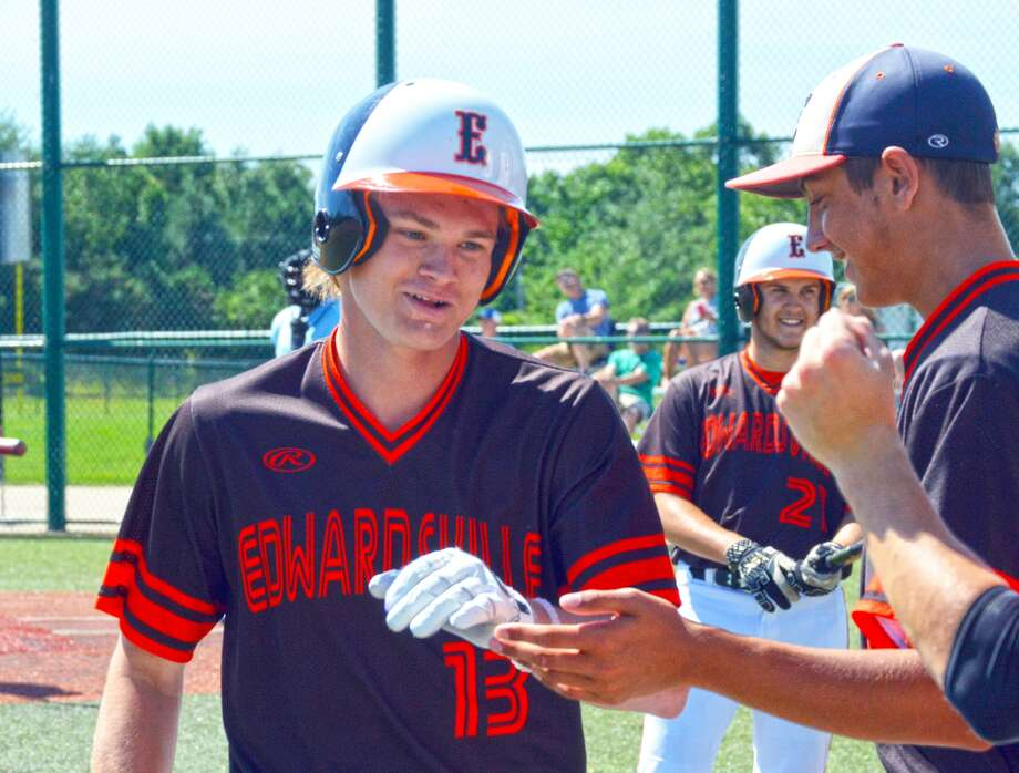 Jonathon Yancik, left, is congratulated by teammates after hitting a solo home run in the second inning of Saturday's game against the St. Louis Prospects.