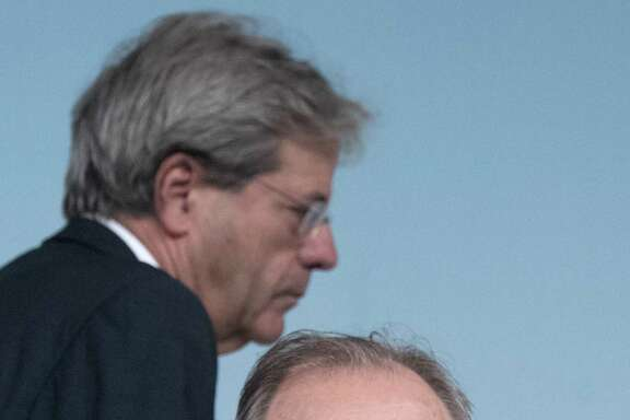 "Italian Prime Minister Paolo Gentiloni, left, and Italian Economy Minister Pier Carlo Padoan, give a press conference after a cabinet meeting at Chigi Palace in Rome, Italy, Sunday, June 25, 2017. The Italian government is making 5.2 billion euros ($5.8 billion) of resources available to keep operative two banks that the European Central Bank last week had deemed ""failing or about to fail,"" sending them into insolvency procedures. (Claudio Peri/ANSA via AP)"