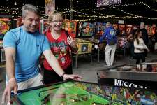 Jim and Ellyn Derby play during the Moon Pinball Expo at the Pacific Pinball Musem in Alameda last year.