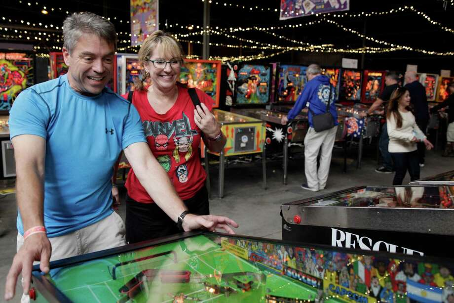 Jim and Ellyn Derby play during the Moon Pinball Expo at the Pacific Pinball Musem in Alameda last year. Photo: Gabriella Angotti-Jones / Gabriella Angotti-Jones / The Chronicle 2016 / ONLINE_YES