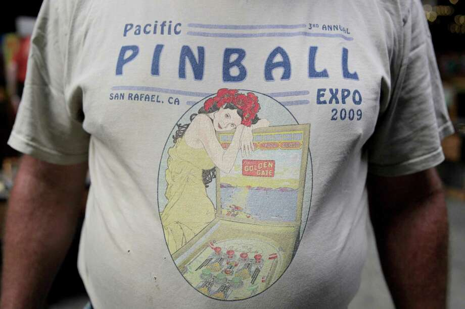 Joe Perry of Alameda wears a shirt from the last Pinball Expo at last year's event in Alameda. Photo: Gabriella Angotti-Jones / Gabriella Angotti-Jones / The Chronicle 2016 / ONLINE_YES