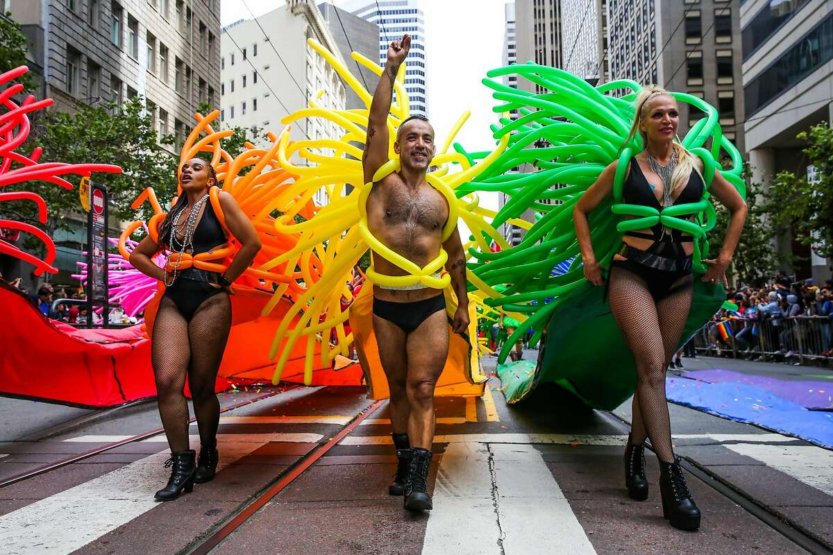 People in costume walk down Market Street during the Pride Parade in San Francisco, California, on Sunday, June 25, 2017.