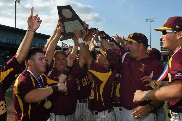 Deer Park Head Baseball Coach Chris Rupp, center, with help from Deer seniors Taylor Lee, left, and Josiah Ortiz, right, hoists the 2017 Class 6A UIL Baseball State Championship trophy after their 7-2 win over San Antonio Reagan in their finals matchup at Dell Diamond in Round Rock on Saturday, June 10, 2017. (Photo by Jerry Baker/Freelance)