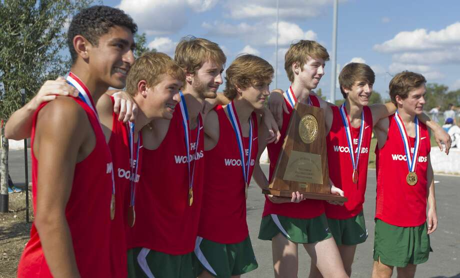 The Woodlands boys cross country/track and fieldDominating the cross country scene isn't new, as The Woodlands has quality and quantity. William Hunsdale, the Chronicle's Boys Runner of the Year, led a trio that finished among the top nine at state, giving the program its second consecutive title and 19th overall.In the spring, The Woodlands mixed distance with others. The Highlanders won four events, getting the expected (Adrian Piperi in shot put) and unexpected (Cecil Gregg in long jump). Kesean Carter (100-meter champion) put the exclamation point on it, marking the first title since 1999. Photo: Jason Fochtman/Houston Chronicle