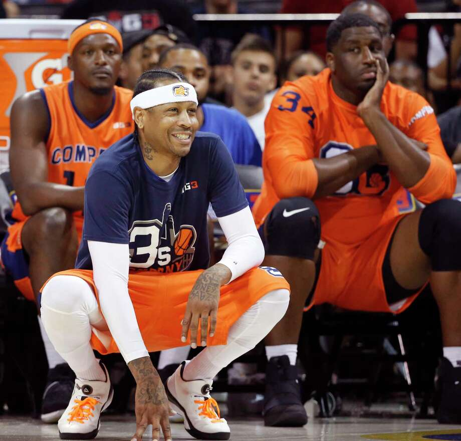 3's Company player/captain and coach Allen Iverson, center, kneels on the sideline during the first half of Game 3 in the BIG3 Basketball League debut, Sunday, June 25, 2017, at the Barclays Center in New York. (AP Photo/Kathy Willens) Photo: Kathy Willens, STF / Copyright 2017 The Associated Press. All rights reserved.