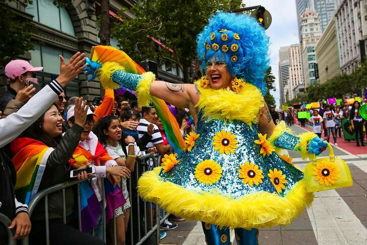 A person in costume high-fives the crowd during the Pride Parade in San Francisco, California, on Sunday, June 25, 2017.