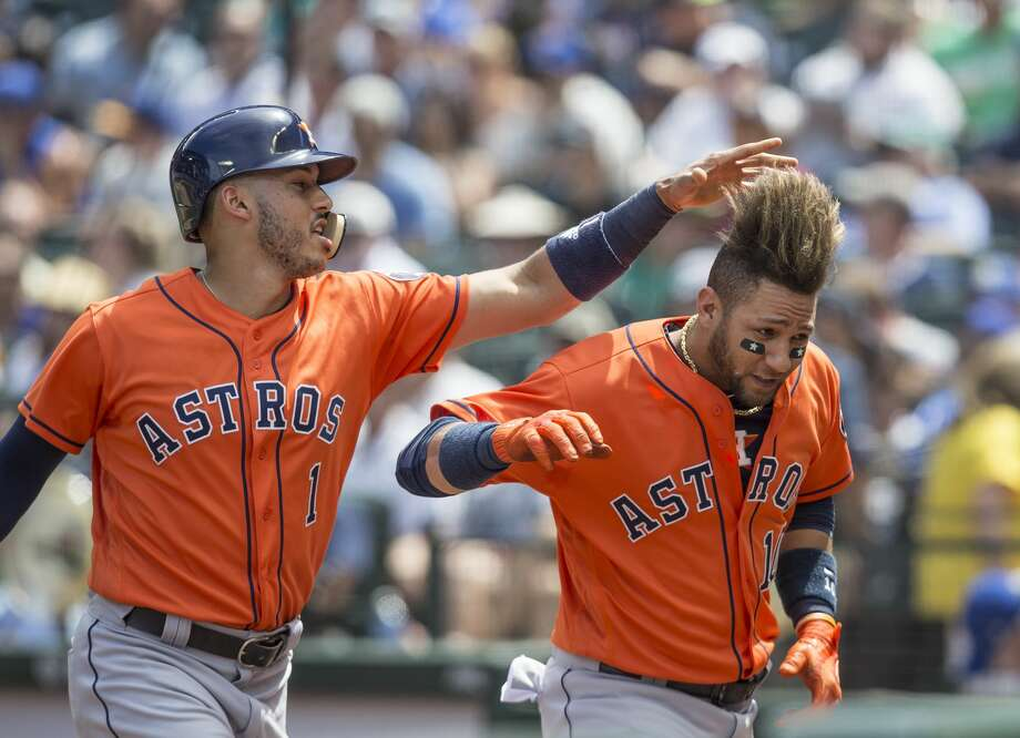 SEATTLE, WA - JUNE 25: Yuli Gurriel #10 of the Houston Astros and Carlos Correa #1 of the Houston Astros celebrate a two-run home run by Gurriel off of starting pitcher Ariel Miranda #37 of the Seattle Mariners that also scored Correa during the fourth inning of a game at Safeco Field on June 25, 2017 in Seattle, Washington. (Photo by Stephen Brashear/Getty Images) Photo: Stephen Brashear/Getty Images