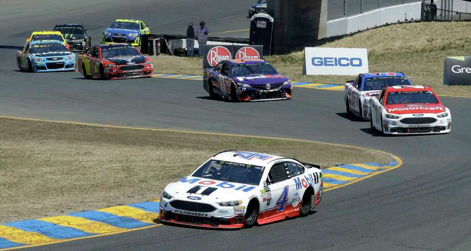 Kevin Harvick (4) leads through a turn during the NASCAR Sprint Cup Series auto race Sunday, June 25, 2017, in Sonoma, Calif. (AP Photo/Ben Margot) Photo: Ben Margot, STF / Copyright 2017 The Associated Press. All rights reserved.