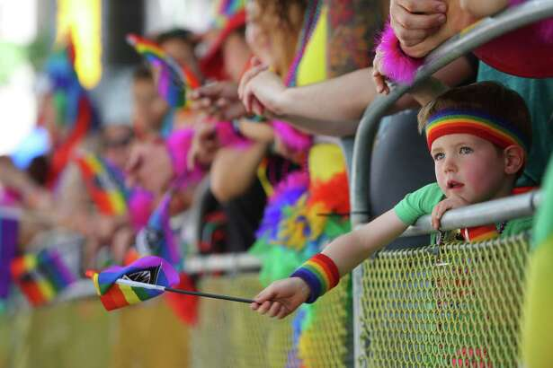 Jack Jungbluth, 4, watches the Seattle Pride Parade, Sunday, June 25, 2017.