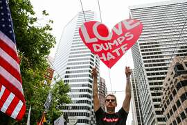 Mark Morris (center) holds up a heart shaped sign during the Pride Parade in San Francisco, California, on Sunday, June 25, 2017.