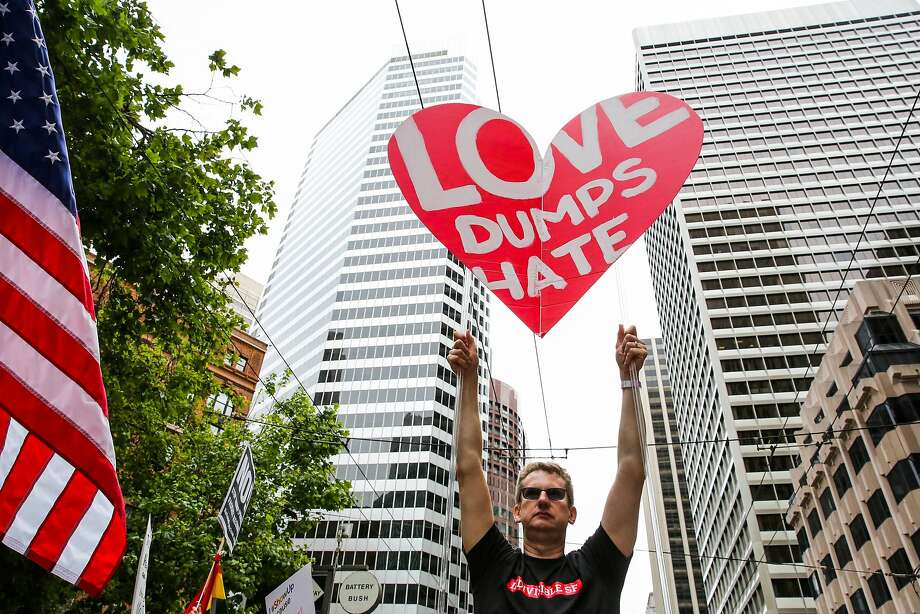 Mark Morris (center) holds up a heart shaped sign during the Pride Parade in San Francisco, California, on Sunday, June 25, 2017. Photo: Gabrielle Lurie, The Chronicle