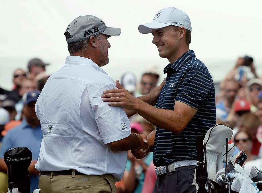 Jordan Spieth, right, greets Boo Weekley, left, on the first tee during the final round of the Travelers Championship golf tournament, Sunday, June 25, 2017, in Cromwell, Conn. Photo: Jessica Hill, FRE / FR125654 AP
