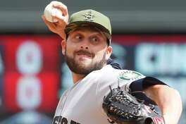 Houston Astros pitcher Jordan Jankowski throws against the Minnesota Twins in relief of starter Brad Peacock in the fifth inning of a baseball game Monday, May 29, 2017 in Minneapolis. (AP Photo/Jim Mone)