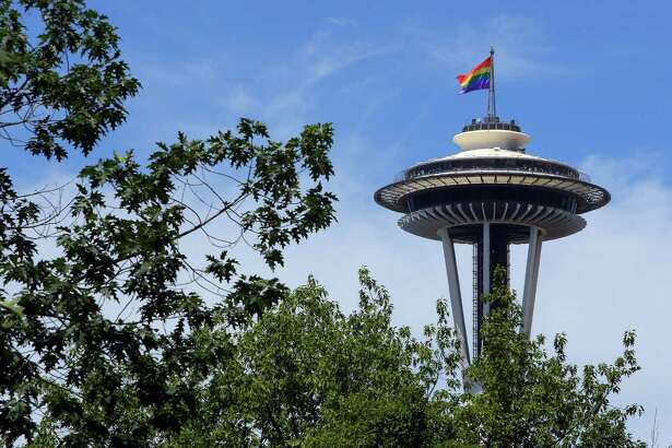 A pride flag tops the Space Needle during the Seattle Pride Parade, Sunday, June 25, 2017.