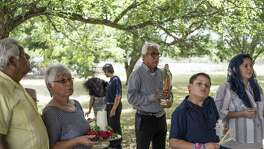 Residents of Von Ormy gather to offer their petitions at an outdoor mass during a special event celebrating Von Ormy's residents' history at Sacred Heart of Jesus Church in Von Army, TX on Sunday, June 25, 2017. The Northwest Vista College Cultural Heritage Project sponsored the event.