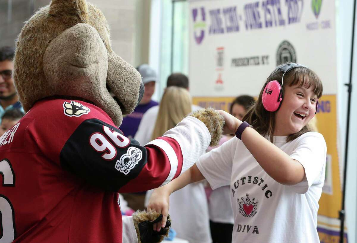 Emily Martin, 13 years old and with autism, is excited to dance with Howler the mascot of Phoenix Coyotes Hockey Club during Breakfast with Mascots at Queensbury Theatre Sunday, June 25, 2017, in Houston. Mascots for a Cure would like to use this event to raise both funds and awareness for childhood cancer while have some fun.