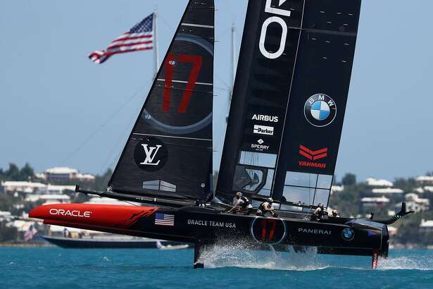 HAMILTON, BERMUDA - JUNE 25:  Oracle Team USA skippered by Jimmy Spithill round a mark on day 4 of the America's Cup Match Presented by Louis Vuitton on June 25, 2017 in Hamilton, Bermuda.  (Photo by Clive Mason/Getty Images)