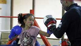 Yemila Tobias work out with coach Jeff Mays.Weighing in at 90 lbs., 12 year old Yemila Tobias is an up and coming boxer training under Jeff Mays, Army retiree and assistant coach for the Women's United States Boxing Team. She Trains at the East Side Boys and girls Club of America on 4/5/2017.