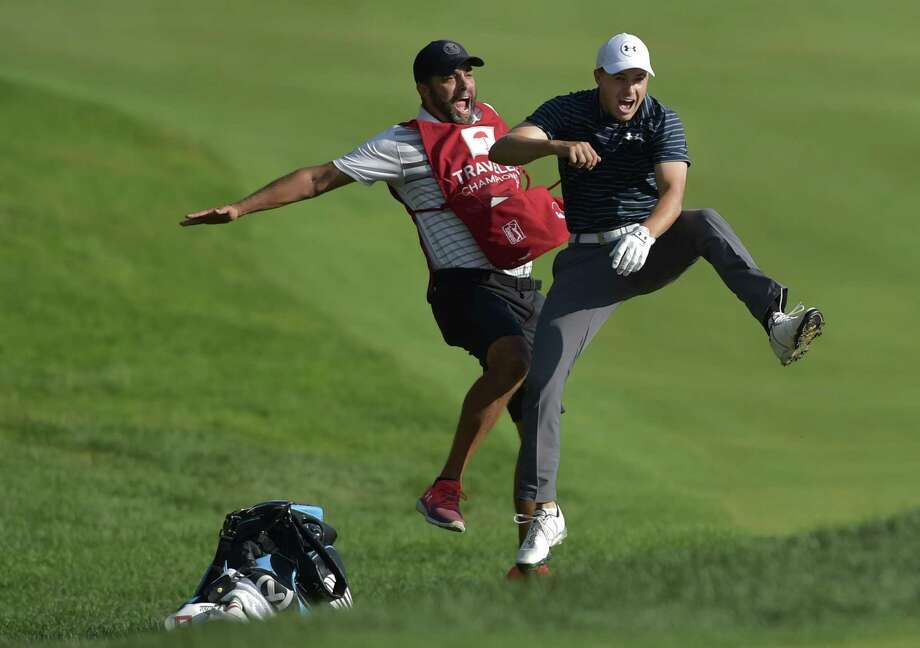 6e3a0463be11e0 Jordan Spieth celebrates with caddie Michael Greller after Spieth holed a  bunker shot on a playoff