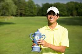 Gross Champion Jason Morilla stands with his trophy after the Town Tournament at the Griffith E. Harris Golf Club in Greenwich, Conn. on Sunday, June 25, 2017.