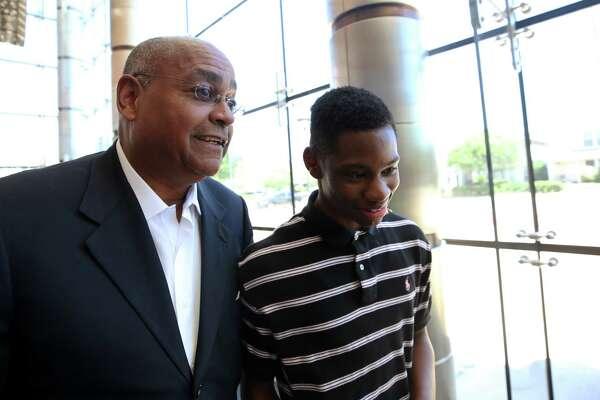 Harris County Commissioner Rodney Ellis speaks with Worthing High School sophomore Darius Hines.