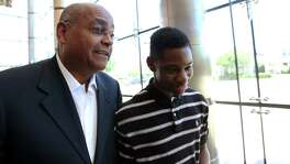 Harris County Commissioner Rodney Ellis speaks with Worthing High School sophomore Darius Hines.