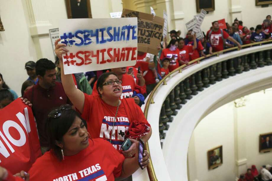 Protesters against Senate Bill 4 gather at the state Capitol in late May. The so-called sanctuary cities bill was signed into law by Gov. Greg Abbott and is to take effect Sept. 1. Photo: Jerry Lara /San Antonio Express-News / © 2017 San Antonio Express-News