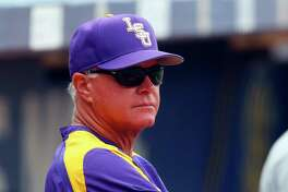 LSU coach Paul Mainieri, left, and Florida's Kevin O'Sullivan are familiar foes, having met three times this season in Southeastern Conference play. The Gators won twice.