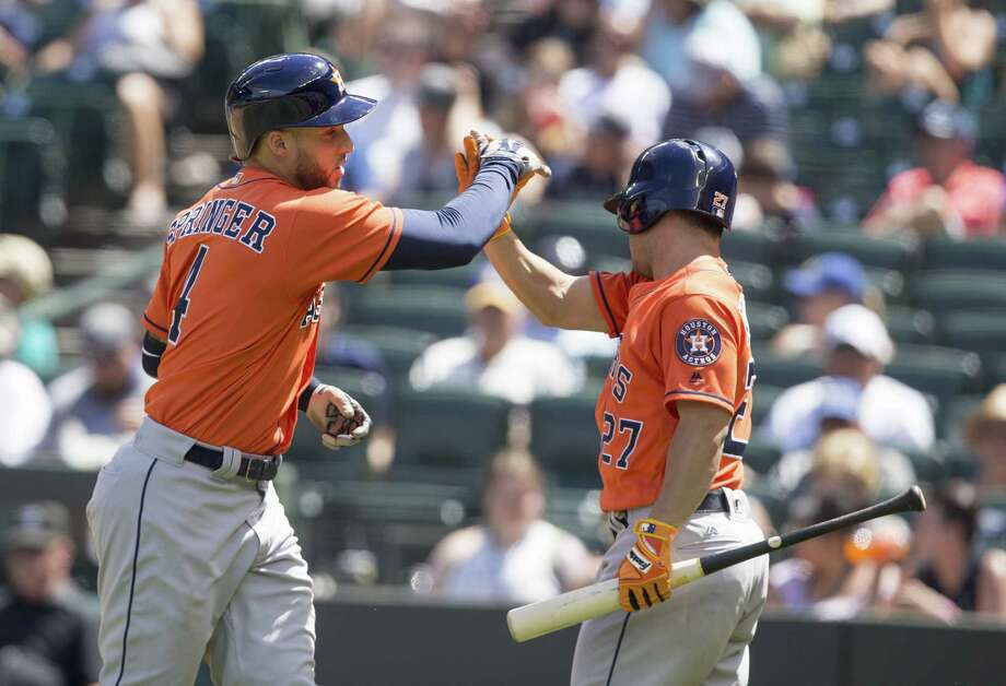 George Springer (4) of the Houston Astros is congratulated by Jose Altuve (27) after hitting a solo home run off of starting pitcher Ariel Miranda #37 of the Seattle Mariners during the fourth inning game at Safeco Field Sunday in Seattle. Photo: Stephen Brashear, Getty Images / 2017 Getty Images