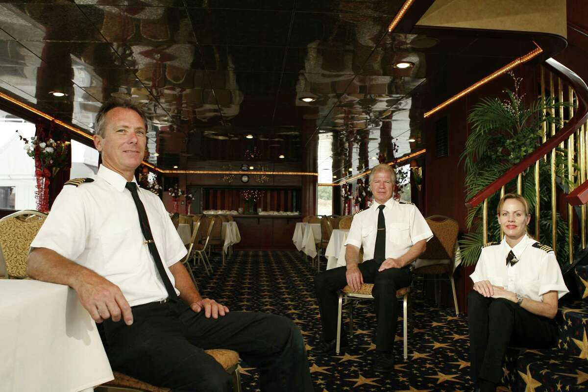 For years, Captains John Litchfield, center, Christina White, right, and Tim Mattison, left, together ran the three yachts for Majestic Ventures, Inc. which specializes in special event, wedding and quincenera cruises. But recent revelations show that White wasn't using her real name.