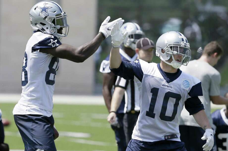 Dallas Cowboys receiver Ryan Switzer (10) gets a high-five from fellow wide receiver Dez Bryant during minicamp on June 13, 2017, in Frisco. Photo: Jaime Dunaway /Associated Press / Copyright 2017 The Associated Press. All rights reserved.