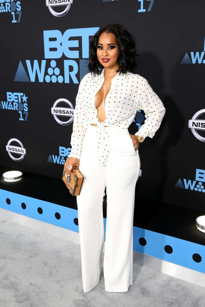 Best: Singer Tammy Rivera Malphurs shows off her professional sexy side in this all-white blouse-pant combination. Photo: Bennett Raglin/Getty Images For BET
