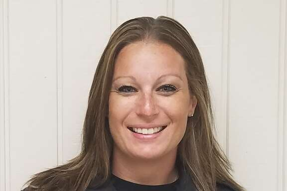 Office Pamela Minchew of the Cleveland ISD police department was off duty on a flight Sunday when she tackled a passenger who tried to open an emergency exit mid-flight.