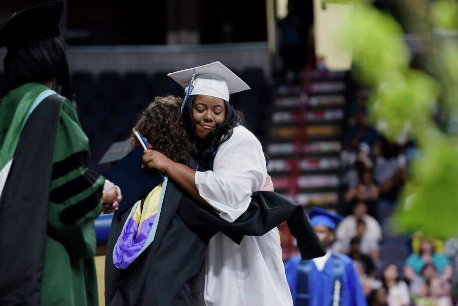 Albany High School graduate Ashiya Campbell-Archeval, hugs Dale Getto, the acting principal of Albany High School, at the Times Union Center during the Albany High School graduation on Sunday, June 25,  2017, in Albany, N.Y.  (Paul Buckowski / Times Union) Photo: PAUL BUCKOWSKI / 20040850A