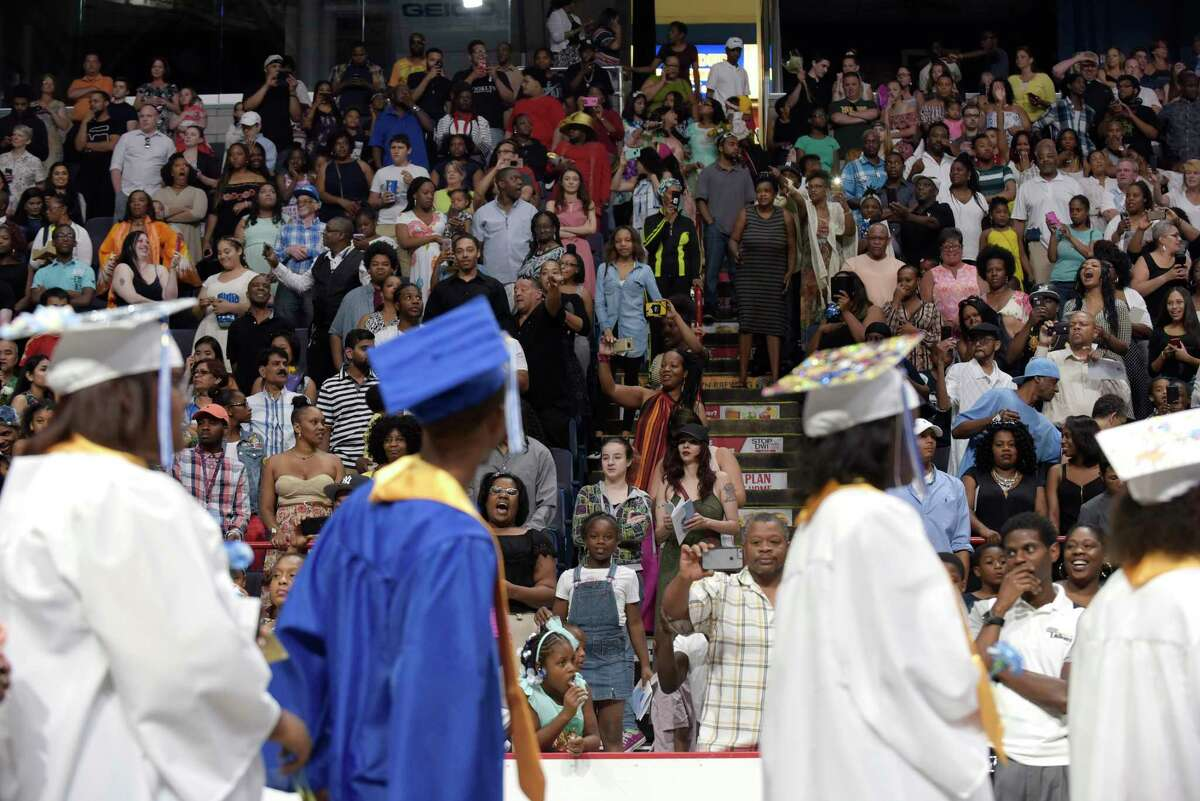 Family and friends watch as Albany High School graduates process in for the start of the school's graduation ceremony at the Times Union Center on Sunday, June 25, 2017, in Albany, N.Y. (Paul Buckowski / Times Union)
