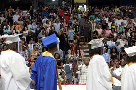 Family and friends watch as Albany High School graduates process in for the start of the school's graduation ceremony at the Times Union Center on Sunday, June 25, 2017, in Albany, N.Y.  (Paul Buckowski / Times Union) Photo: PAUL BUCKOWSKI / 20040850A