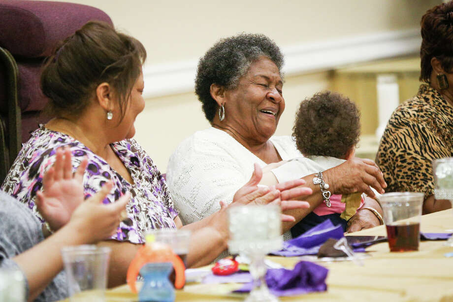 """Dorothy Williams, wife of the late James """"Popsicle"""" Williams, laughs while accompanied by her daughter Gayle as Popsicle's classmates tell stories about him during the Booker T. Washington Alumni Association 12th Annual Scholarship Banquet on Saturday at Union Center AME Church in Conroe. Photo: Michael Minasi, Staff Photographer / © 2017 Houston Chronicle"""