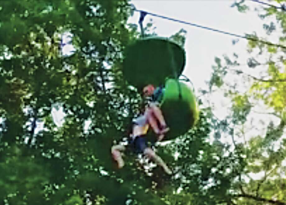 A 14-year-old girl hangs from the Sky Ride at Great Escape on Saturday, June 24, 2017. Park patrons gathered below to help and a Schenectady man broke her fall. (Courtesy of Loren Lent)