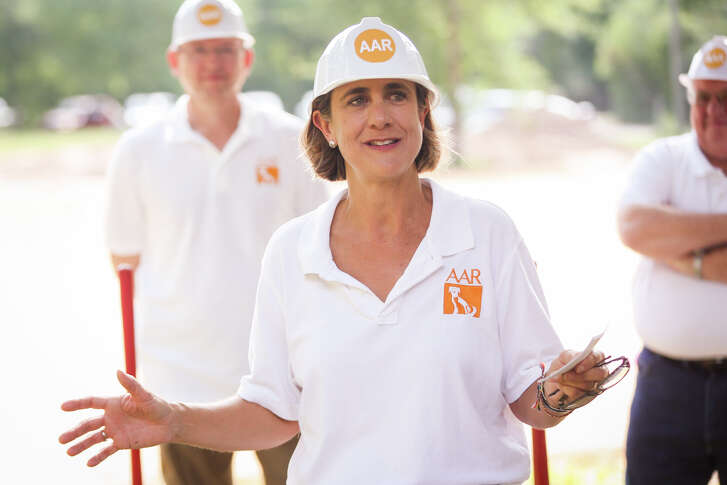 Debbie Allison, Abandoned Animal Rescue director, speaks during the groundbreaking ceremony for the animal rescue's new facility on Friday off of Wright Road in Magnolia.