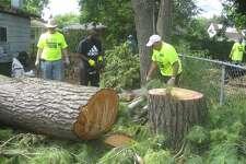 Mike Fisher, Calvin, Chuck Zemanek and Greg Janoch volunteer during One Week One Street June 2017 in Saginaw.