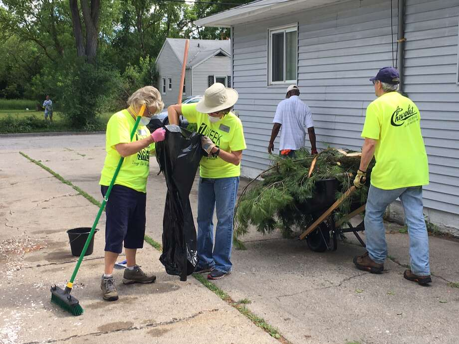 FILE — Linda Yoder, Laura Perkins and Greg Janoch volunteer during One Week One Street June 2017 in Saginaw. Click through the gallery to see more photos from past events.  Photo: Photo Provided