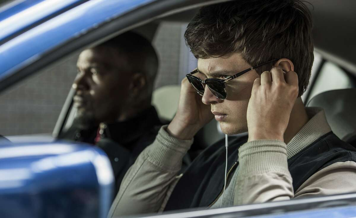 """This image released by Sony Pictures shows Ansel Elgort, right, and Jamie Foxx in a scene from """"Baby Driver."""" (Wilson Webb/Sony/TriStar Pictures via AP)"""