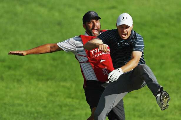Jordan Spieth celebrates with caddie Michael Greller after chipping in for birdie from a bunker on the 18th green to win the Travelers Championship in a playoff against Daniel Berger, at TPC River Highlands on June 25, 2017 in Cromwell, Connecticut. (Photo by Maddie Meyer/Getty Images)