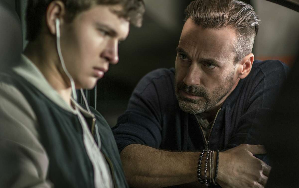 """This image released by Sony/TriStar shows Ansel Elgort, left, and Jon Hamm in a scene from the film, """"Baby Driver."""" (Wilson Webb/Sony/TriStar via AP)"""