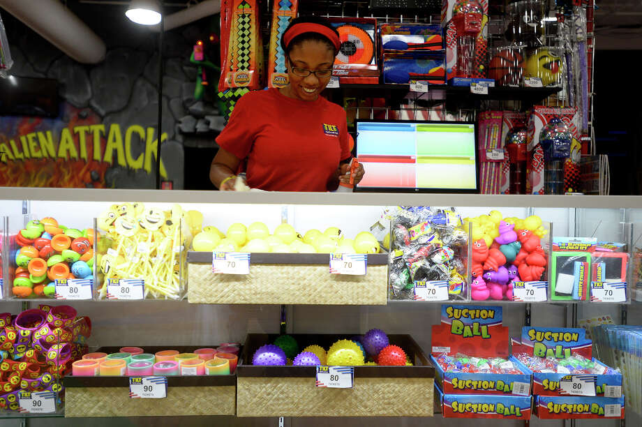 Cristina Franklin cleans the prize counter at Tilt Studio in Parkdale Mall on Thursday afternoon. Franklin is working this summer to help pay for her upcoming freshman year at Grambling State University.  Photo taken Thursday 6/22/17 Ryan Pelham/The Enterprise Photo: Ryan Pelham / ©2017 The Beaumont Enterprise/Ryan Pelham